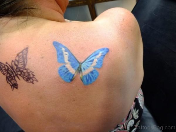Blue And Black Butterfly Tattoo