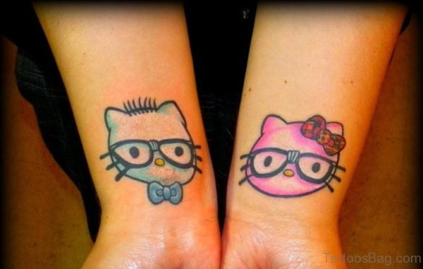 Blue And Pink kitty Wrist Tattoo