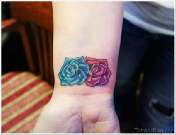 Blue And Roses Tattoo On Wrist
