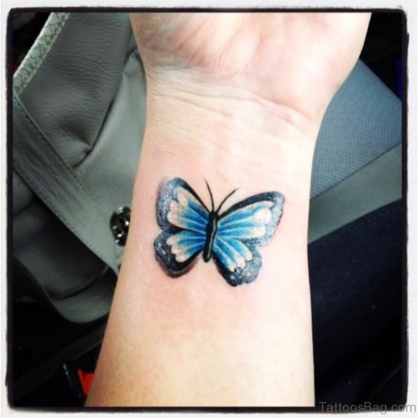Blue Butterfly Tattoo On Wrist