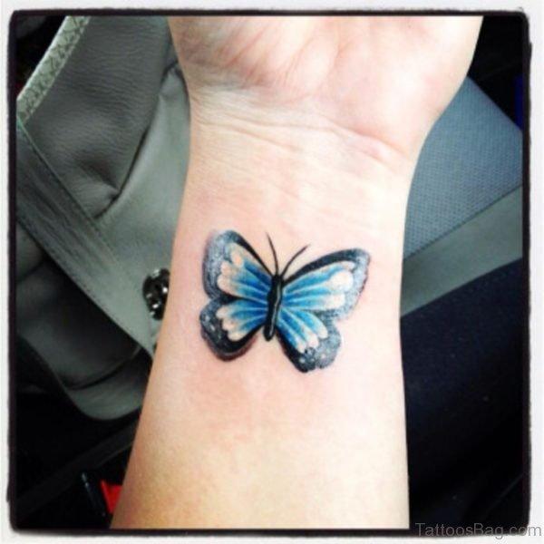 Blue Butterfly Tattoo On Wrist