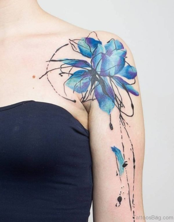 Blue Colored Tattoo On Shoulder