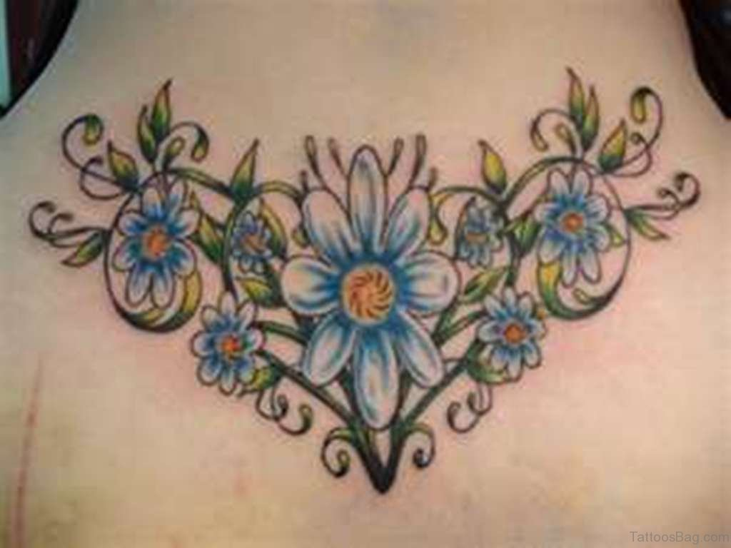 34 traditional daisy flowers tattoos designs on back blue daisy tattoo on back izmirmasajfo