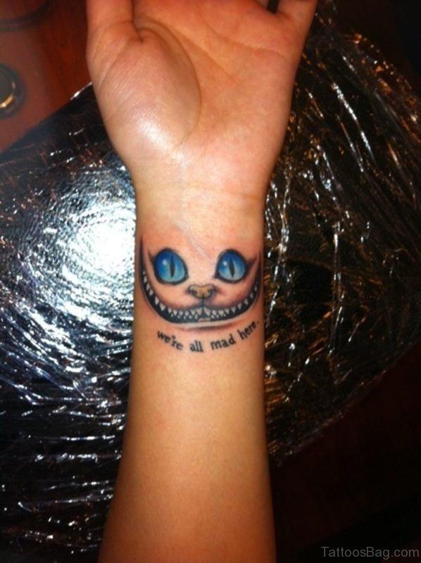 Blue Ink  Cat Tattoo On Wrist