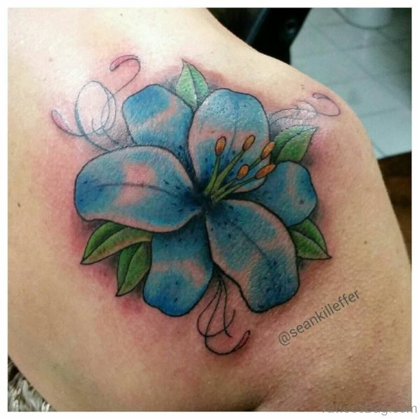 Blue Lily Tattoo On Back Shoulder