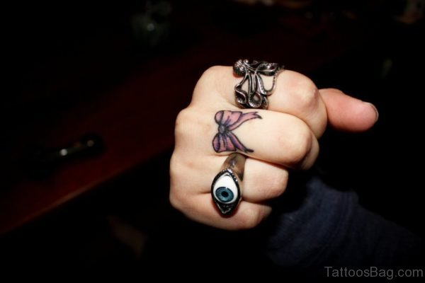 Bow Tattoo On Finger