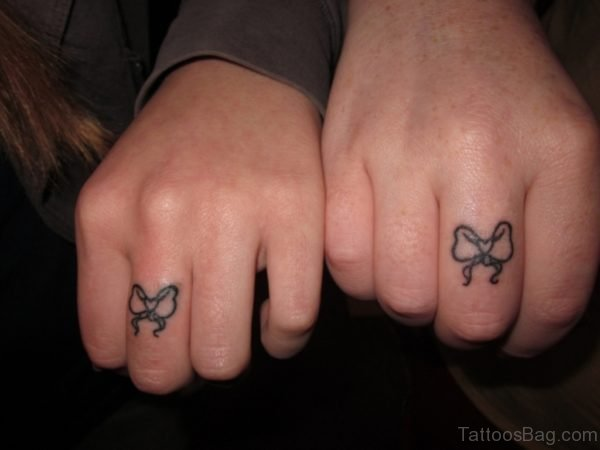 Bow Tattoos On Fingers