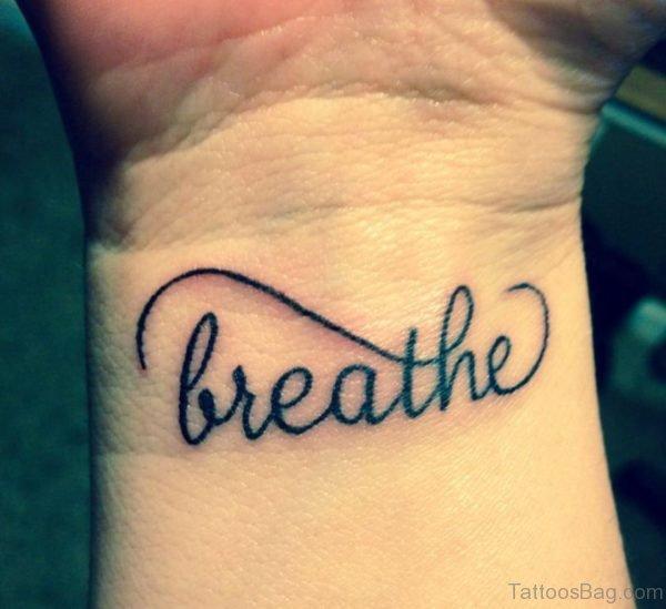 Breathe Lettering Tattoo On Wrist