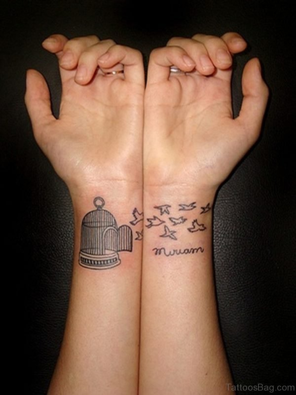 Cage And Birds Tattoo On Wrist