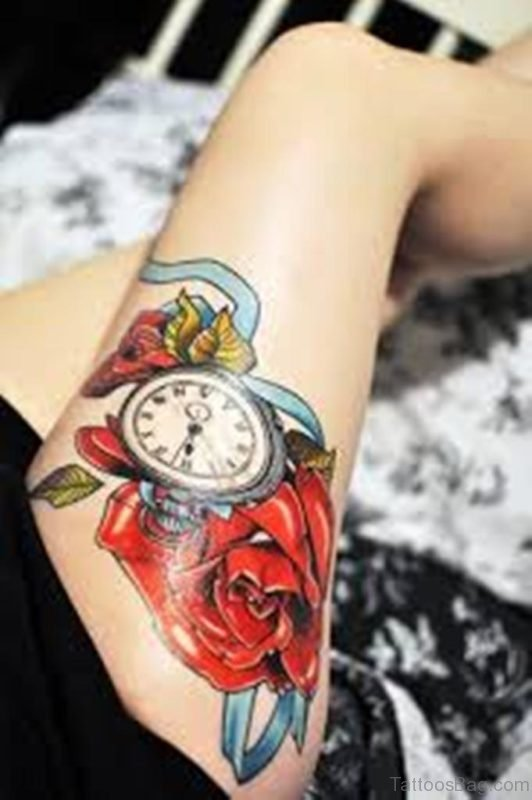 Captivating Clock And Thigh Rose Tattoo