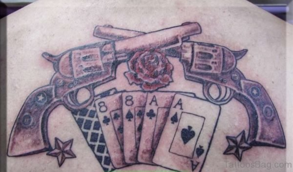 Cards And Gun Tattoo On Back