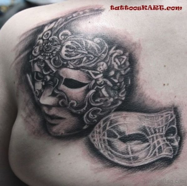 Charming Mask Tattoo On Upper Back