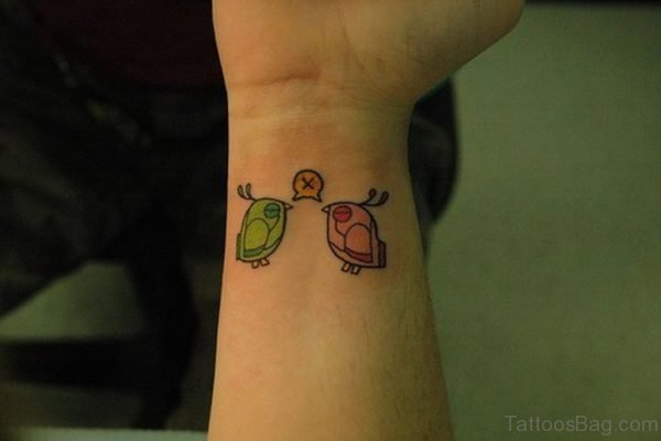 Colored Bird Tattoo On Wrist