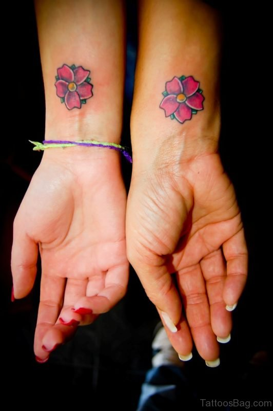 Colored Flower Tattoo On Wrist