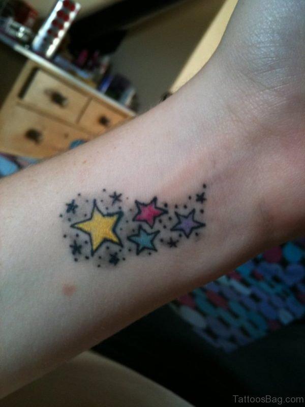 Colored Stars Tattoo On Wrist