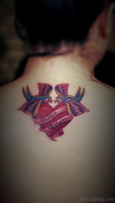 Colored Swallow Heart Tattoo On Back