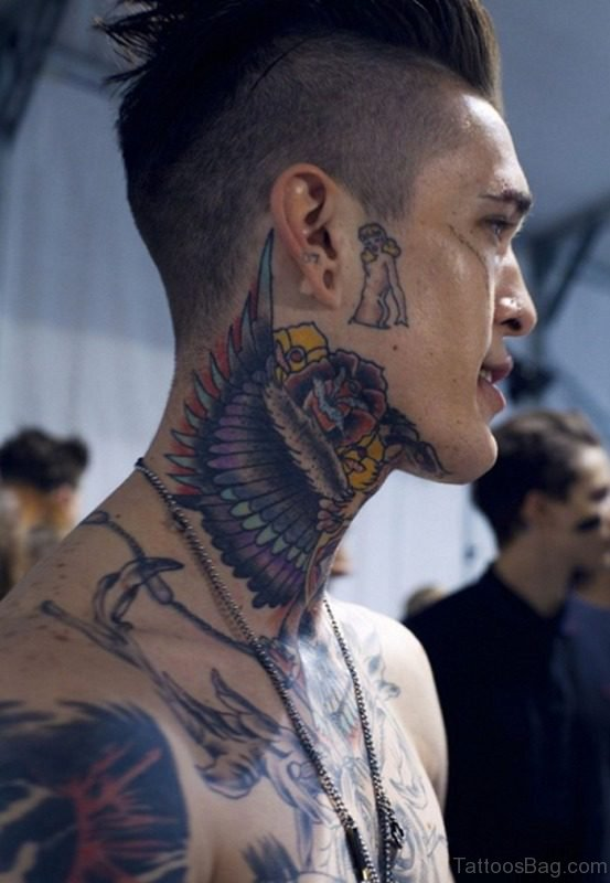 Colored Winged Tattoo On Neck