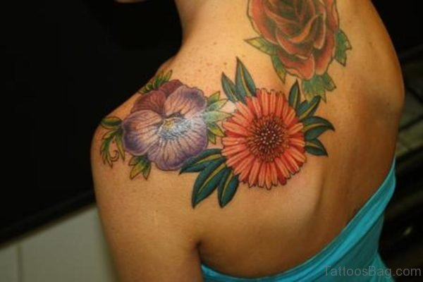 Colorful Daisy And Rose Tattoo On Girl Left Back