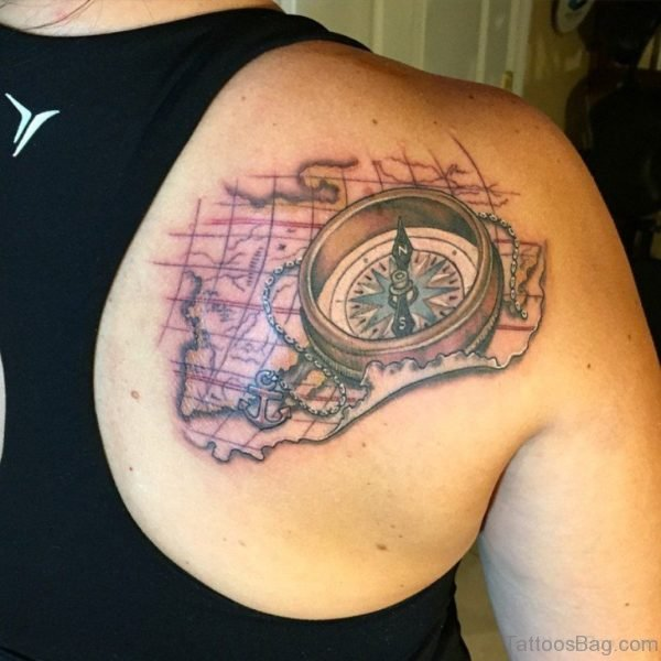 Compass And Map Tattoo On Back