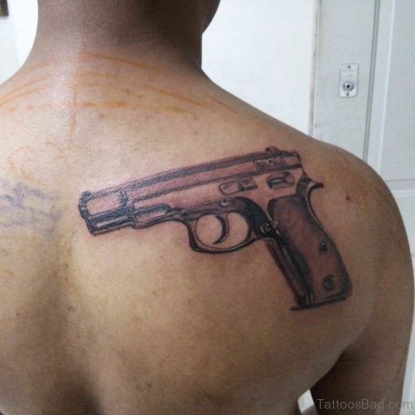 Cool Gun Tattoo On Back