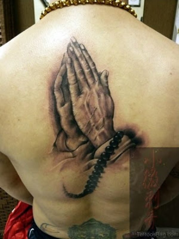 Cool Praying Hands Tattoo On Back
