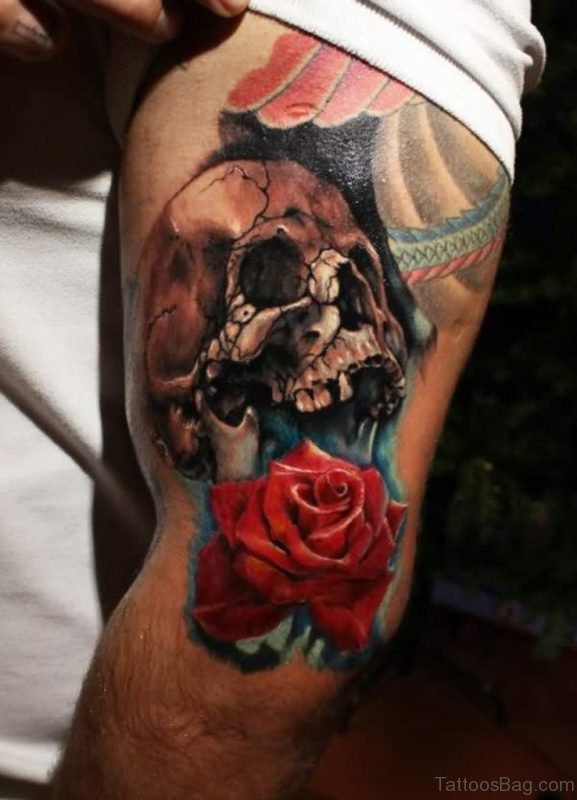 Cracked Skull And Red Rose Tattoo
