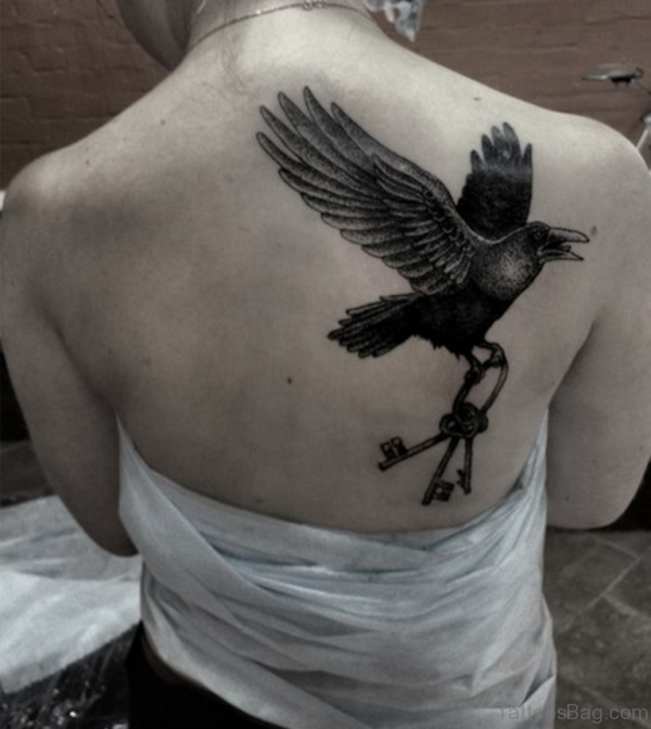 Crow And Key Tattoo On Back