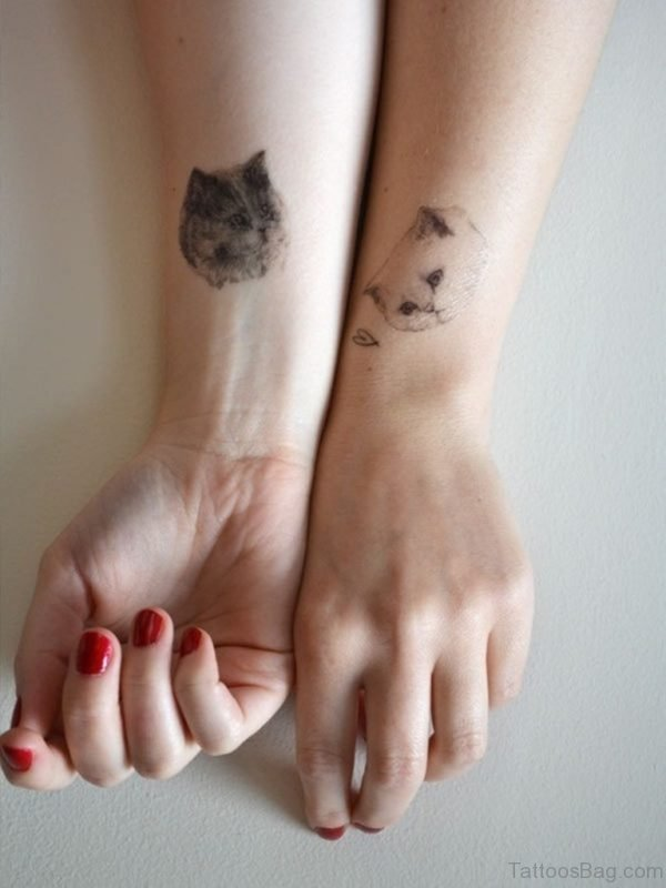 Cute Face  Cat Tattoo On Wrist
