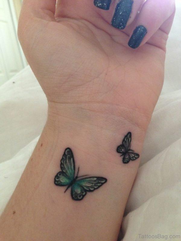 Cute Green Butterfly Tattoo On Wrist