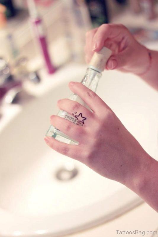 Cute Star Tattoo On Finger