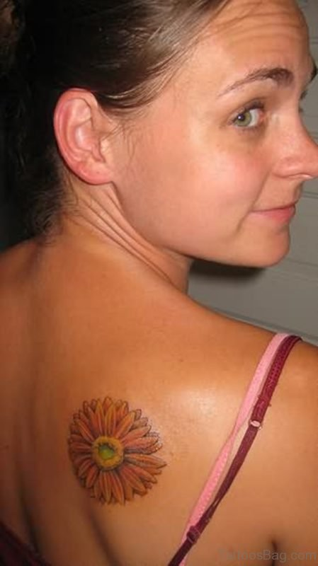 Daisy Flower Tattoo On Girl Right Back