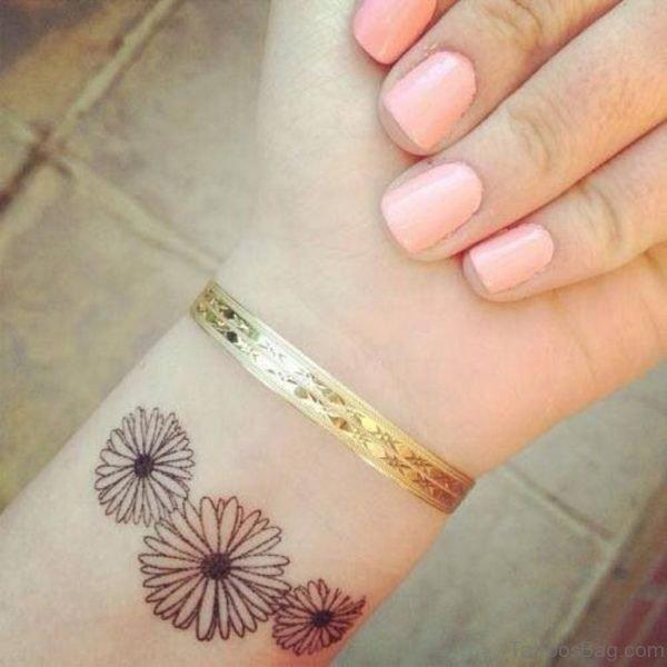Daisy Flower Tattoo On Wrist