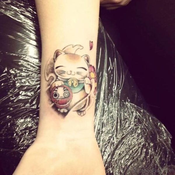 Doll And kitty Wrist Tattoo