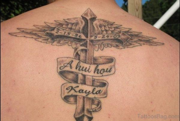 Elegant Cross Wings Tattoo