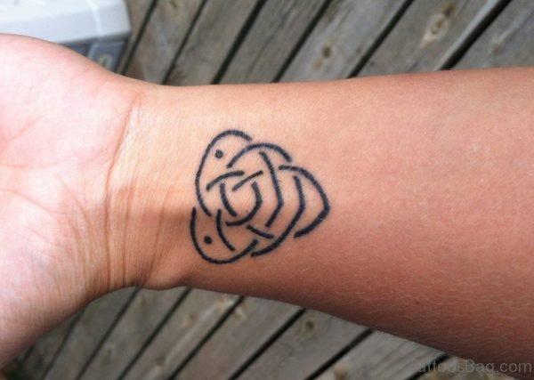 Elegant Wrist Tattoo