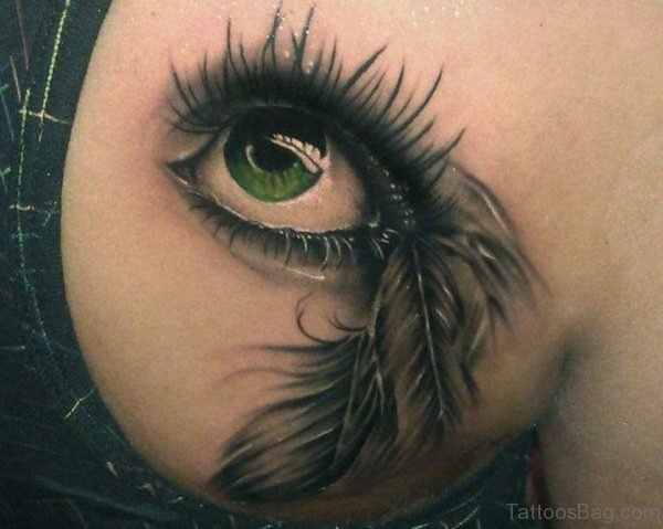 Eye And Feather Tattoo On Back