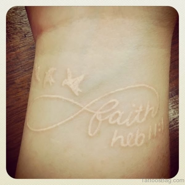 Faith Flying Birds White Ink Tattoo On Wrist