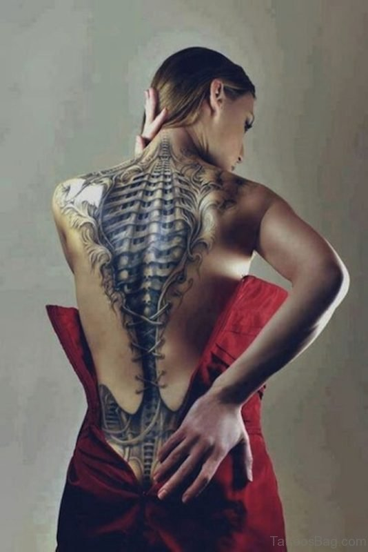 Fancy Biomechanical Tattoo On Girl Back