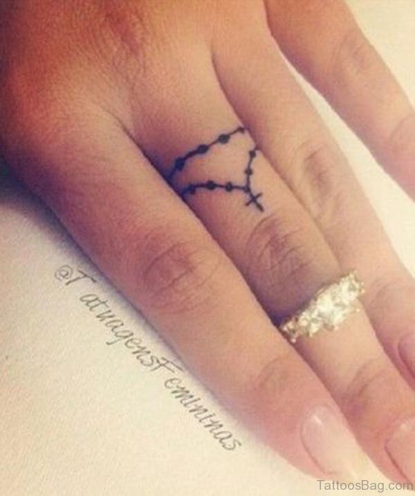 Fine Cross Tattoo
