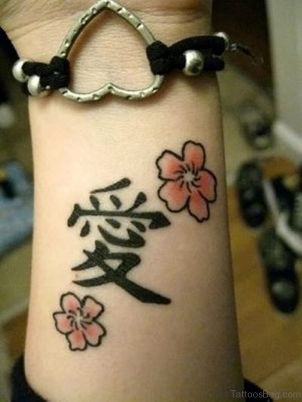 Flower And Chinese Word Tattoo On Wrist