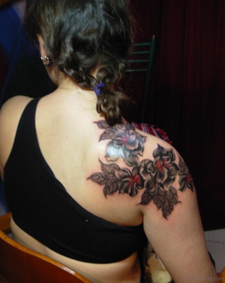 Black flower tattoo on shoulder