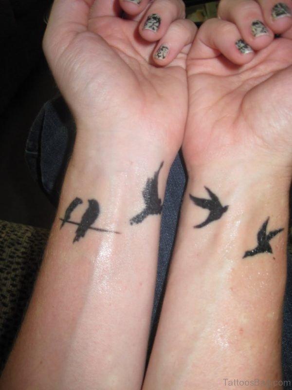 Flying Birds Tattoos On Girl Wrist