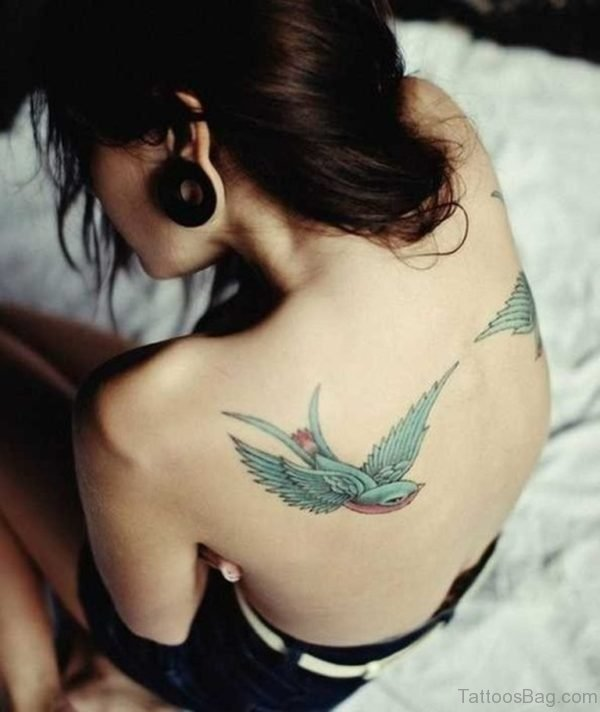 Flying Colored Swallow Tattoo On Back