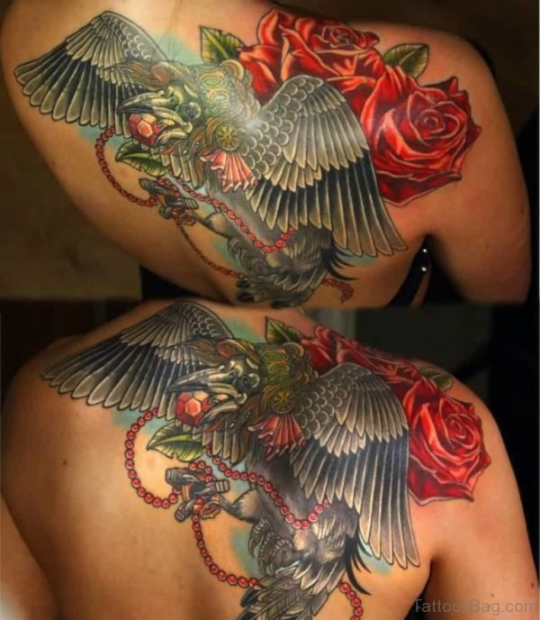 Flying Crow And Lovely Red Flowers Tattoo
