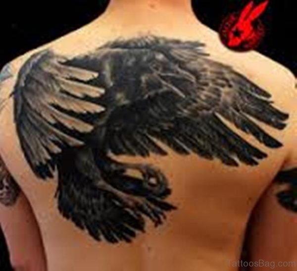 Funky Feather Tattoo On Back
