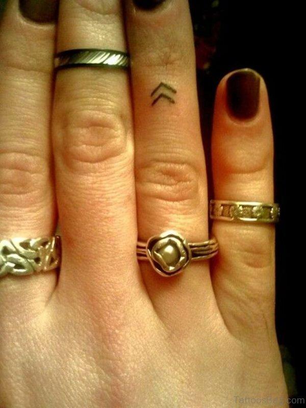 Funky Finger Tattoo