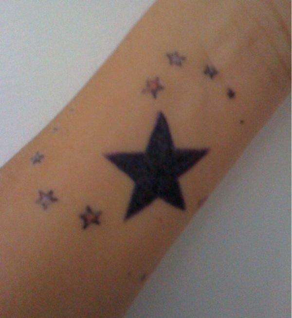 Funky Star Tattoo On Wrist