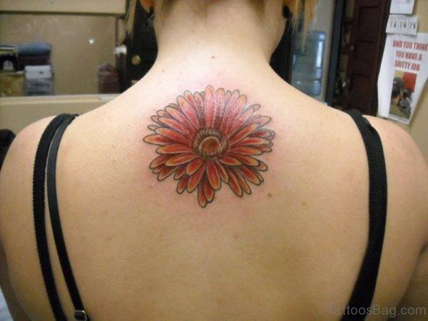 Gerber Daisy Tattoo Design On Upper Back
