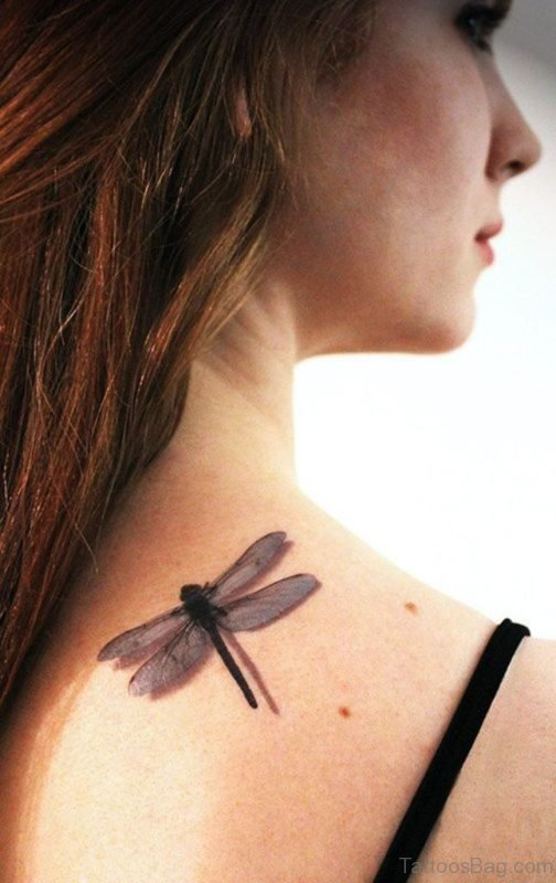 Girl Showing Her  Dragonfly Tattoo