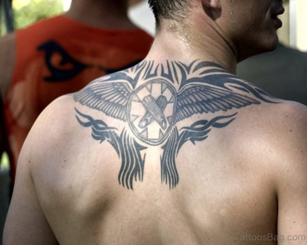 Graceful Tribal Tattoo On Back